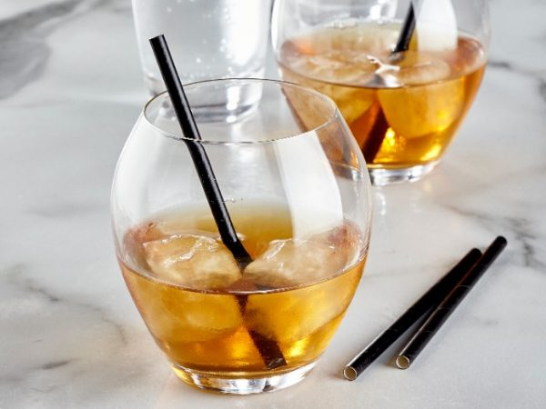 Short black paper drinking sip straw in a short tumbler