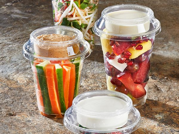 Clear compostable cup with separate portion pot in lid
