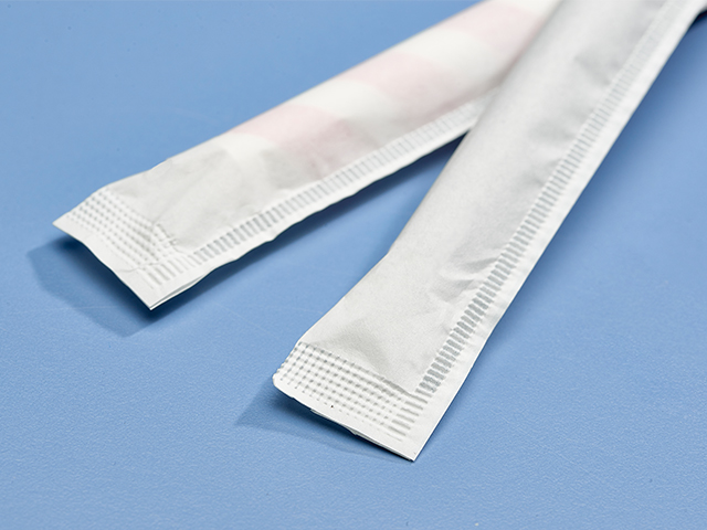 Wrapped paper straws, close up of crimped wrapper